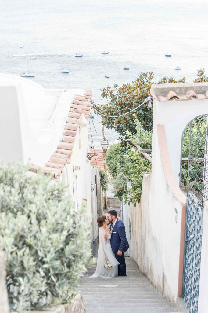 Bride and groom on a narrow street of Positano, Italy