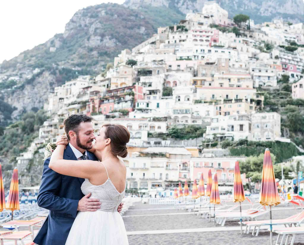 Bride and groom at beach in Positano