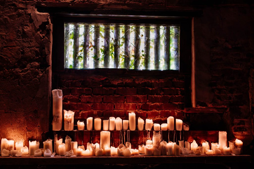 Candles at an eco friendly wedding venue.